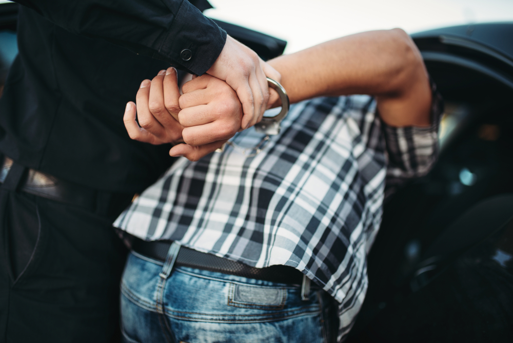 man being hancuffed