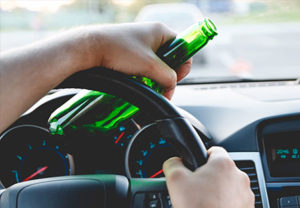 individual driving with an open bottle